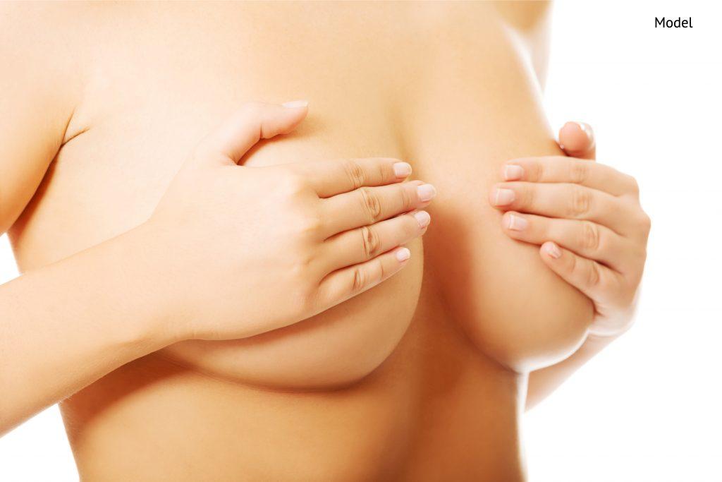 healthy woman examining her breast-img-blog